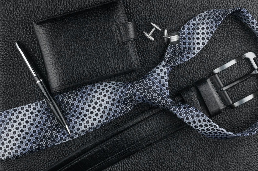tie, belt, wallet, cufflinks, pen lying on the skin, can be used as background